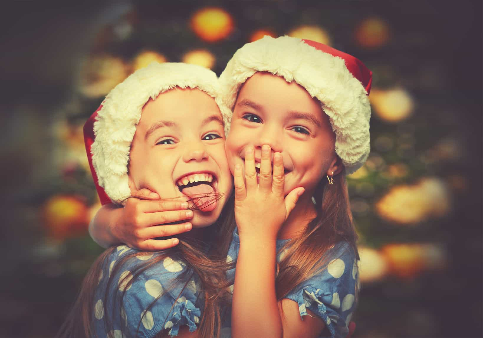 43355212 - christmas happy funny children twins sisters hugging