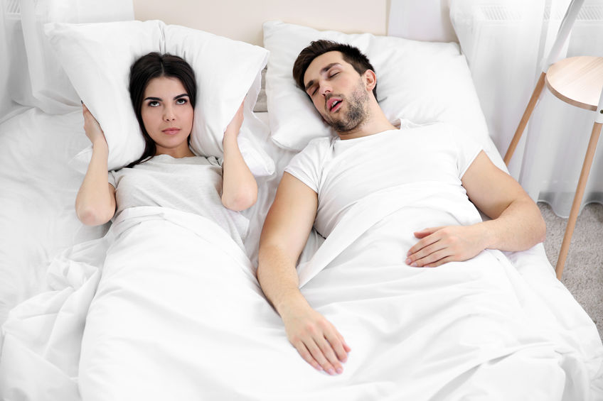 Young girl can't sleep because of her man's snoring.